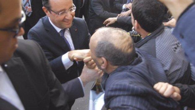 للتذكير فقط: المواطن الجزائري مُقبّل يد الرئيس الفرنسي حصل على فيزا لفرنسا مدى الحياة